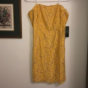 Yellow lace strapless mini dress